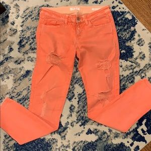 Guess distressed women's orange skinny jeans